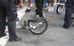 photo of a mangled bicycle after a crash with a car