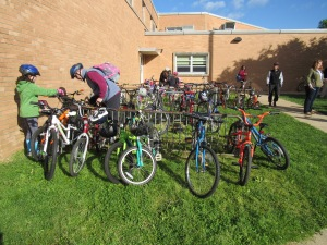 photo of students arriving by bike at John R. Downes Elementary School